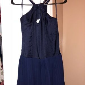 Navy romper with pleated shorts, size M NWT